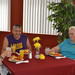 Thumb-resident-dining-at-mesa-senior-living