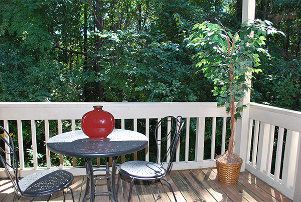 Balcony opening to wooded area