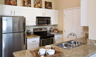 Kitchen with stainless steel appliences at apartments in Riverside