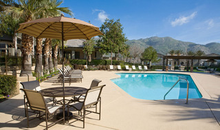 Plenty of space by the pool in Riverside with views of the hills