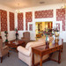 Thumb-relaxing-community-room-at-troy-senior-living-home
