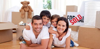 Happy family moving into self storage
