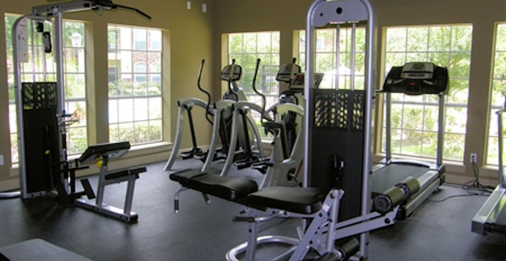 Fitness center at apartments in Houston