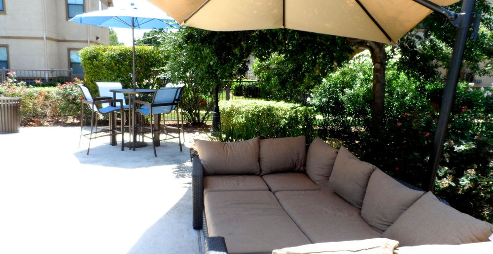 Outdoor patio at apartments in Bryan