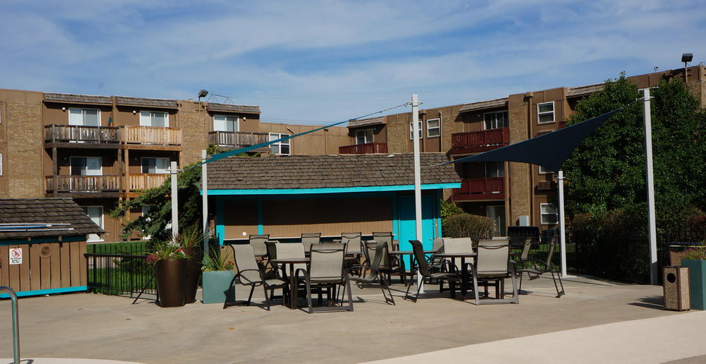 Exterior by the pool at Mission area apartments