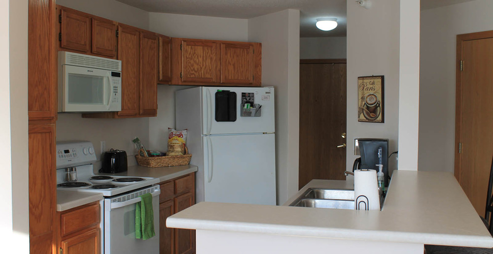 Comfortable kitchen at Pleasant Prairie apartments