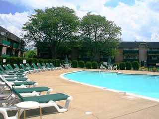 Relax at pool in the Dearborn Heights apartments