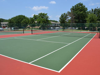 Tennis courts are offered at the Evansville apartments