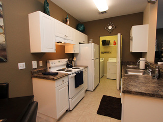 Kitchen offers an area for laundry