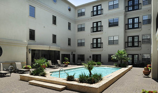 Community courtyard and swimming pool at apartments