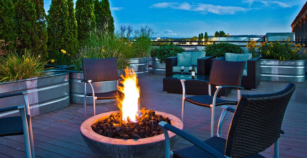 Warmth in Seattle by fire pit on apartment rooftop