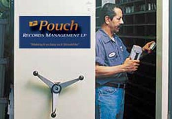 Pouch employee performs routine backup tape rotation