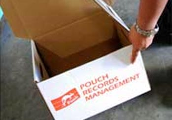 Sales associate at Pouch Records Management reaches into box