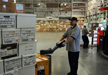 Pouch employee moving boxes