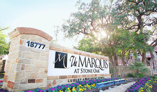 Stone oaks apartments entry sign