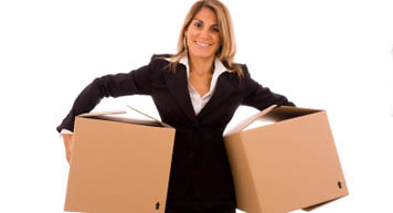 Business woman packs boxes for business storage at Extra Storage.