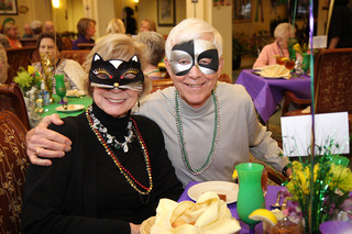 Masked party goers dallas tx senior living