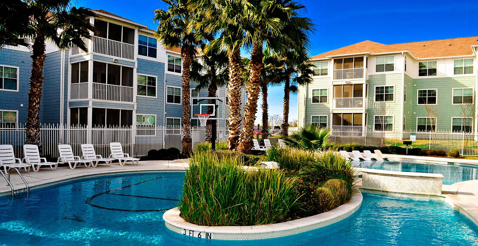 A view of our San Marcos apartments swimming pool and courtyard