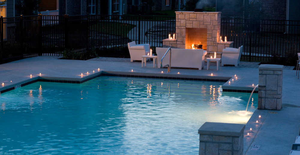 Big outdoor fireplace and pool in Lafayette apartments