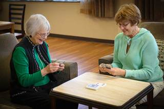 Des moines senior living residents playing cards