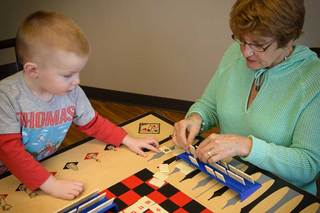 Senior living des moines resident playing game with grandson