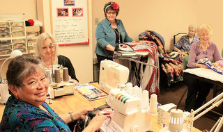 Residents sewing senior living northlake
