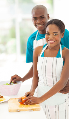 Afam couple cooking
