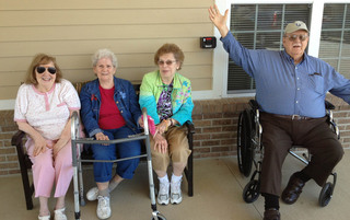 Fort Wayne senior living residents relaxing on the front porch