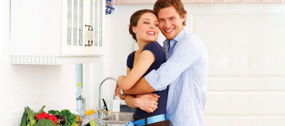 Couple in kitchen at apartments