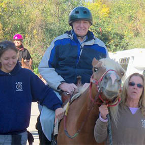 Horseback riding at Senior Assisted Living with Pathway Senior Living LLC