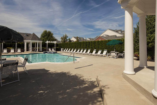Relax by pool at rochester hills apartments