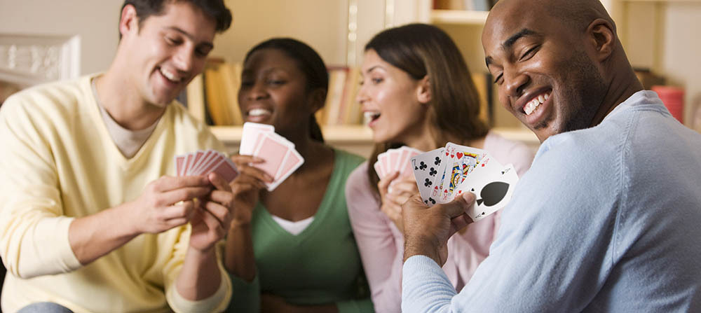 Apartments residents play a card game