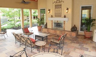 Fireplace on the patio at apartments in Pearland