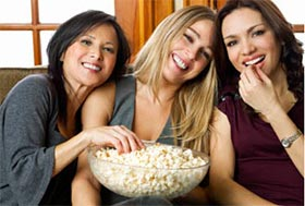 Friends at Mustang apartments enjoying a bowl of delicious gluten free popcorn!