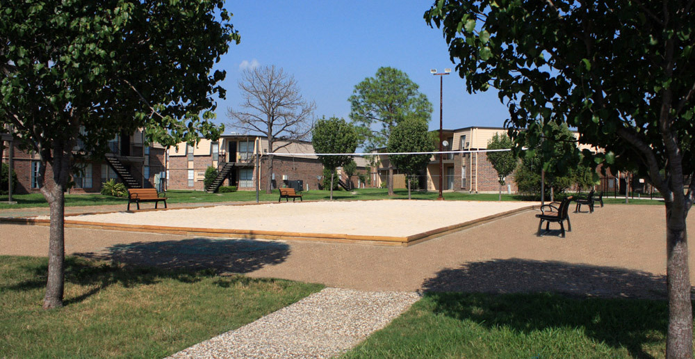 Volleyball court at Baytown apartments