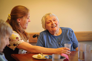 Resident dining at Chandler House Alzheimer's and Related Dementia Care
