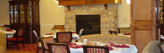 Dining room at edmond senior living with a cozy fireplace