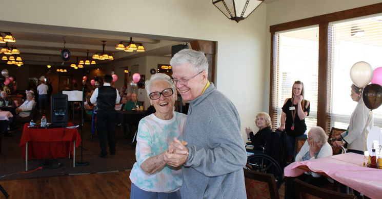 Elder couple dancing