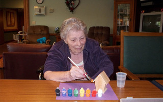Resident painting in Milford senior living