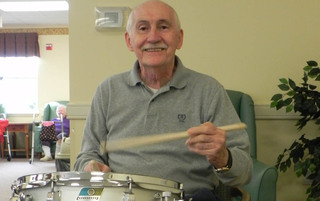 Resident playing drums in Boyertown senior living