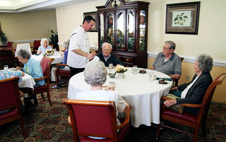 Senior living in Lynchburg enjoy eating food