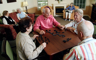Senior living in Lynchburg playing a game of dominos