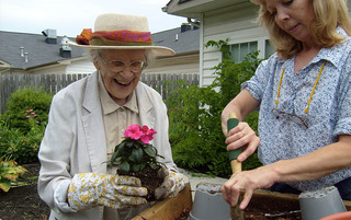 Residents gardening at the senior living in Lynchburg