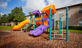 Lake Mary apartments offers a playground for your children to enjoy