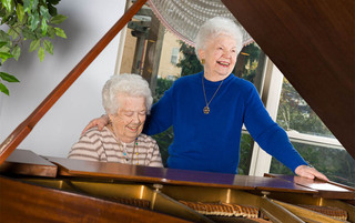 Residents singing and playing the piano at the senior living in Reading