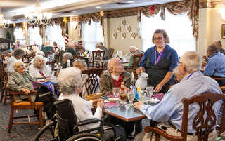 Reading senior living residenst enjoy some food