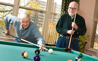 Reading senior living residents enjoying a game of pool