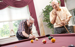 Senior living in York enjoying a game of pool