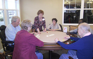 Card games at the senior living in Palmyra