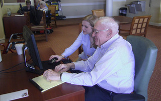 Residents learning computer operations in Palmyra senior living